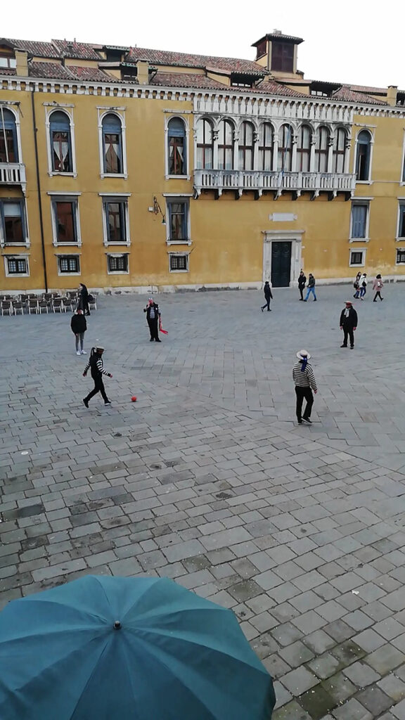 Gondaliers playing football at Campo Santo Stefano in Venice.