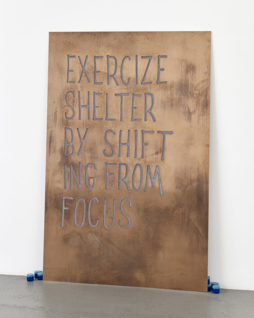 Artwork by Navid Nuur of text written in Vaporub on a large copper plate.