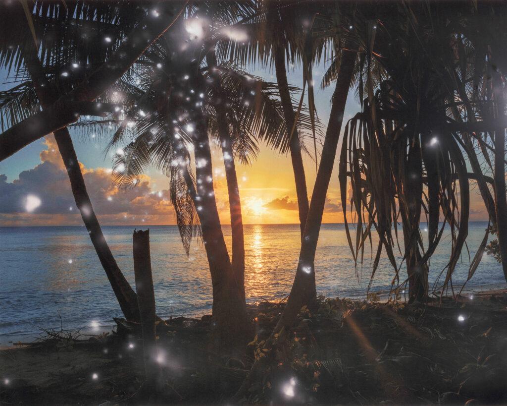 Photograph of sunset at the beach at Bikini Atoll by Julian Charriere