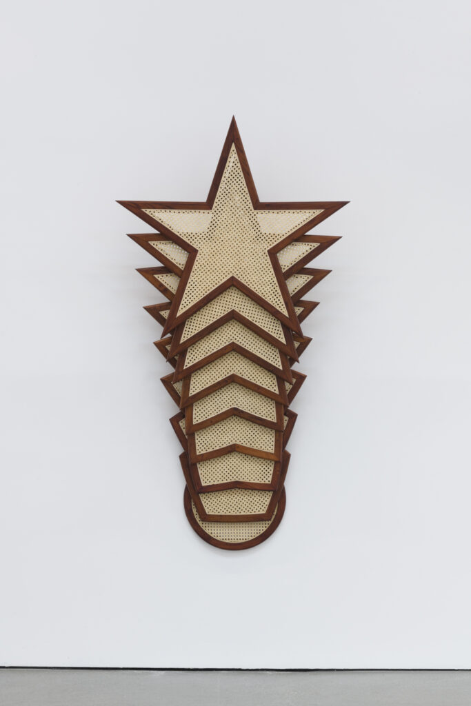 Vertically layered stars made from rattan and wood.