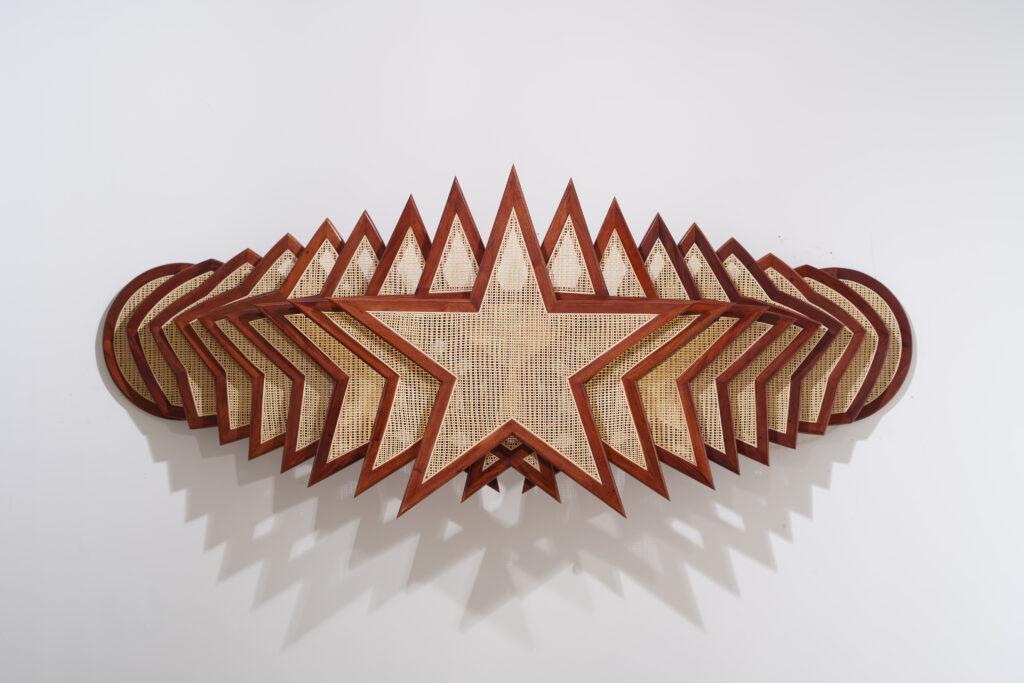 Horizontally layered stars made from rattan and wood