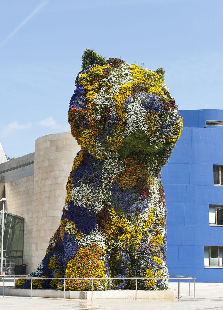 Jeff Koons flower Puppy artwork outside the Guggenheim Bilbao Museum